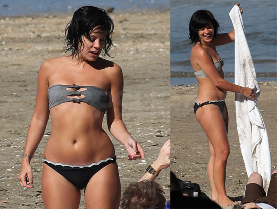 Photos of lily allen playin on the beach in a bikini in new zealand