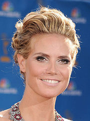 Heidi Klum gets the hair off her face with this updo with high lights