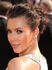 Kim Kardashian brunette pulled back updo hairstyle