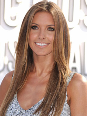 ... with her usual long, sun-kissed hair and creamy, nude makeup palette.