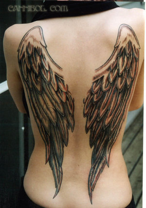 Cool Upper Back Tattoo