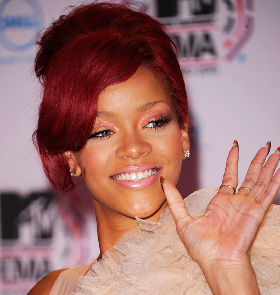 pictures of rihanna with long red hair. rihanna red hair long 2010.