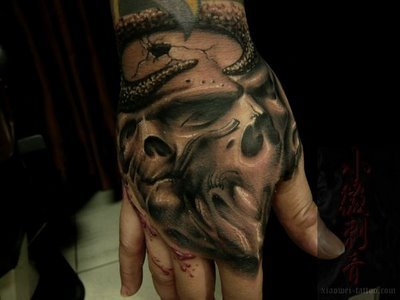 skull tattoos on hands. hand free tattoo design, skull