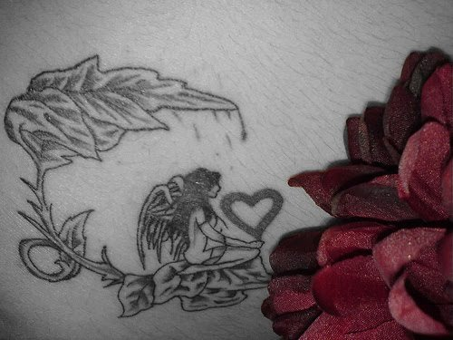 Roses tattoo actually make sense overall interest is 'Beauty and the