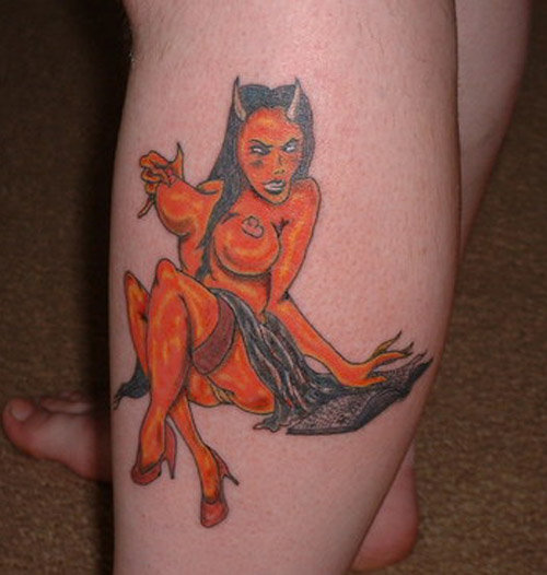 has three visible tattoos on her body, one of which is a small red devil