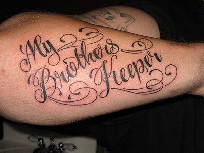 Cursive Letter Tattoo