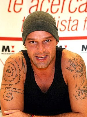 Enjoy these pictures of Ricky Martin and his interesting tattoos.