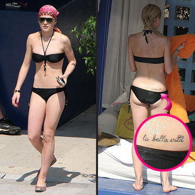 Eva Longoria and Lindsay Lohan. See the lower back tattoos below.