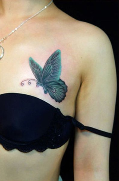 Butterfly tattoo meaning for Butterfly breast tattoos