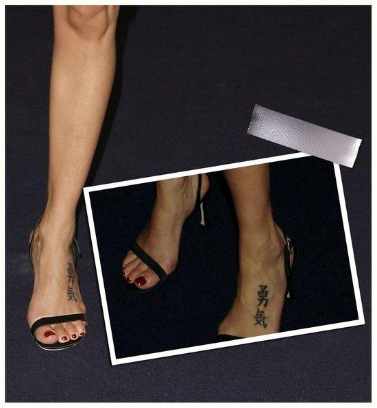 Natalie Imbruglia sanskrit tattoo on foot.