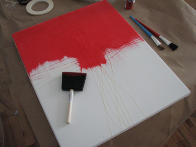 I picked a perfect red...careful to make sure tape is secure against canvas so there is no bleed under it!