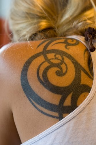 tribal tattoo designs women. Women Back Tribal tattoo