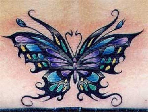amor tattoos. amor vincit omnia side tattoo.