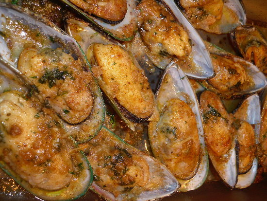 New Zealand Half Shell Mussels Baked In A White Wine Butter Sauce Top With Bread Crumbs and Parm Cheese