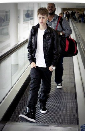 justin bieber leather jacket 2011. Justin Bieber at Heathrow
