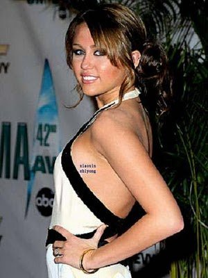 miley cyrus tattoo 2011. Miley Cyrus tattoo boobs