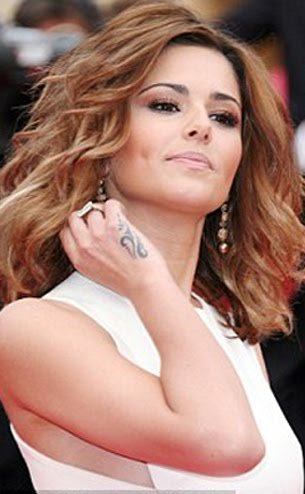 cheryl cole tattoo on bum. cheryl cole tattoo on hand.