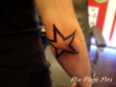 star tattoo on elbow. Star tattoo around elbow
