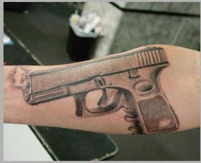 guns tattoos. gun tattoos designs