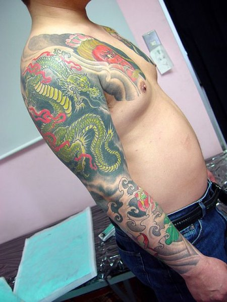 dragon sleeve tattoo. Dragon Sleeve Tattoos