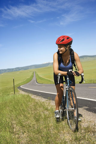 woman on road bike