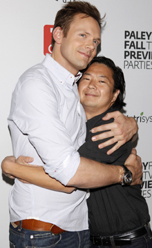 Joel McHale and Ken Jeong hug