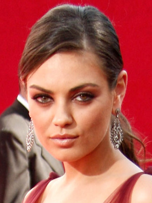 Mila Kunis usually looks like the girl next door, but tonight she had a ...